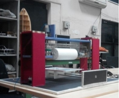 Development of an automated buffing machine to impart multidirectional burnished surface finish for sheets